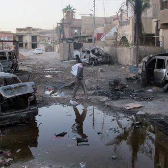 The aftermath of a bombing in Baghdad's al-Jadidah district (AP)
