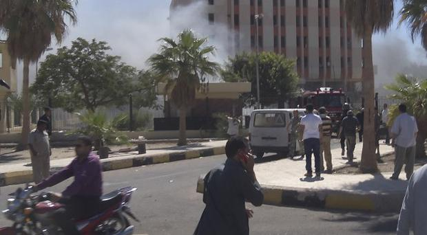 Smoke rises from a security headquarters building in the southern Sinai town of el-Tor, Egypt (AP)
