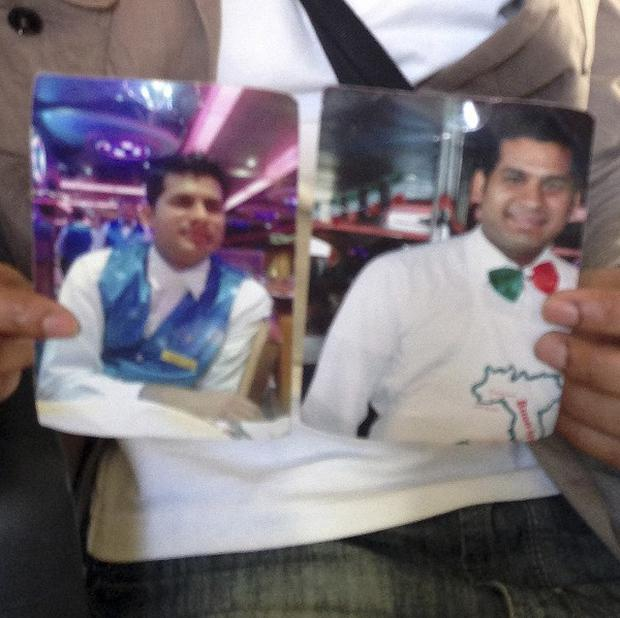 Kevin Rebello, from India, shows two pictures of his brother Russel, a waiter on the Costa Concordia ship (AP)