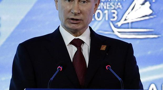 Russia president Vladimir Putin called for an apology from the Netherlands over the arrest of a top Russian diplomat (AP)