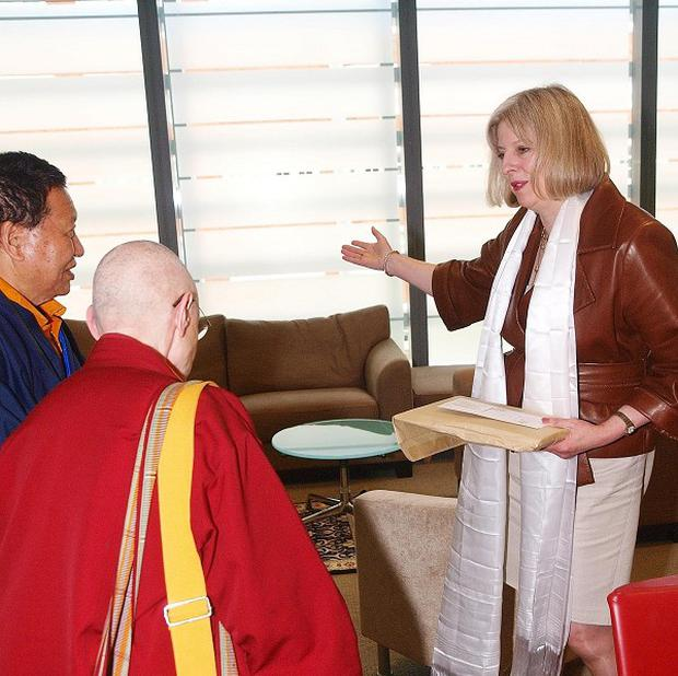 Dr Choje Akong Rinpoche (second left) met Theresa May in 2011