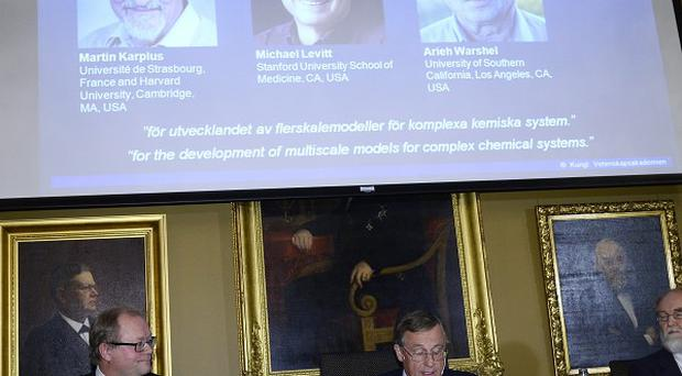 Chairman Sven Lidin, left, permanent secretary Staffan Normark, centre, and professor Gunnar Karlstrom of the Royal Swedish Academy of Sciences announce the winners of the 2013 Nobel Prize in chemistry (AP)