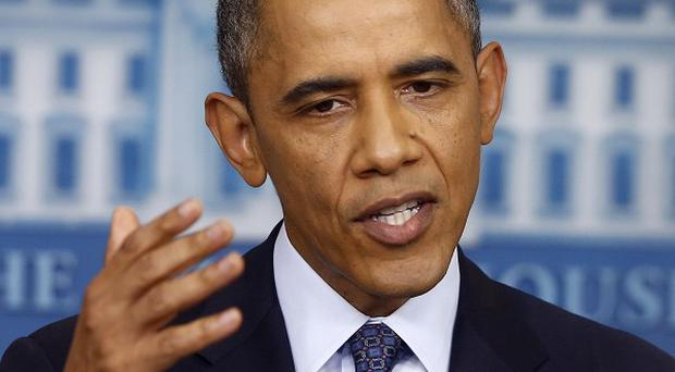 Barack Obama said he will not sign a debt limit increase if conditions are attached (AP/Charles Dharapak)