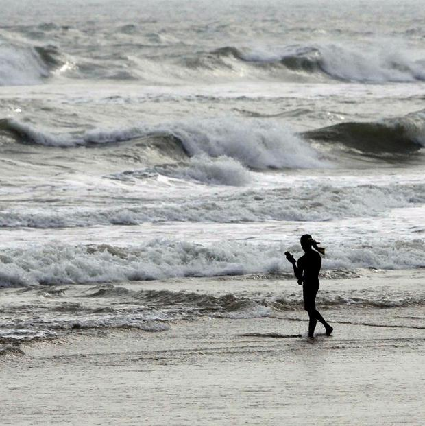 A lone fisherman walks on a beach during a cyclone alert on the Bay of Bengal coast at Puri, Odisha state, India. (AP)