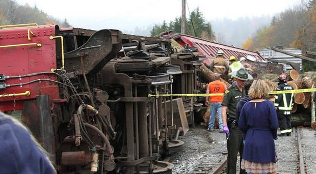 A truck carrying logs down Cheat Mountain crashed into the side of a train taking passengers on a scenic tour in rural Randolph County, West Virginia (AP/The Pocahontas Times, Geoff Hamill)