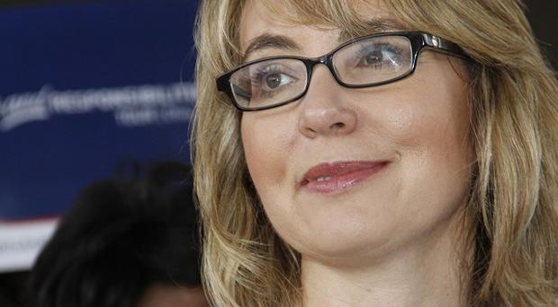 Gabrielle Giffords is set to tour a New York gun show as part of a move to tighten gun control - her first such visit since she was shot in 2011 (AP)