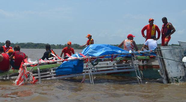 Rescue workers search for survivors in a capsized boat on the Amazon River near Macapa, Brazil (AP)