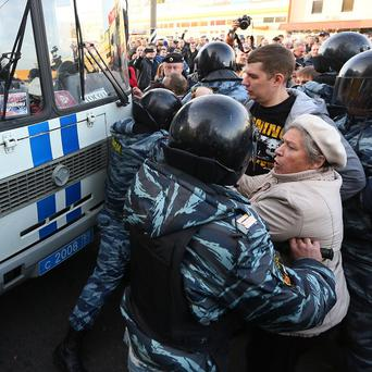 Police and protesters clash in Moscow (AP)