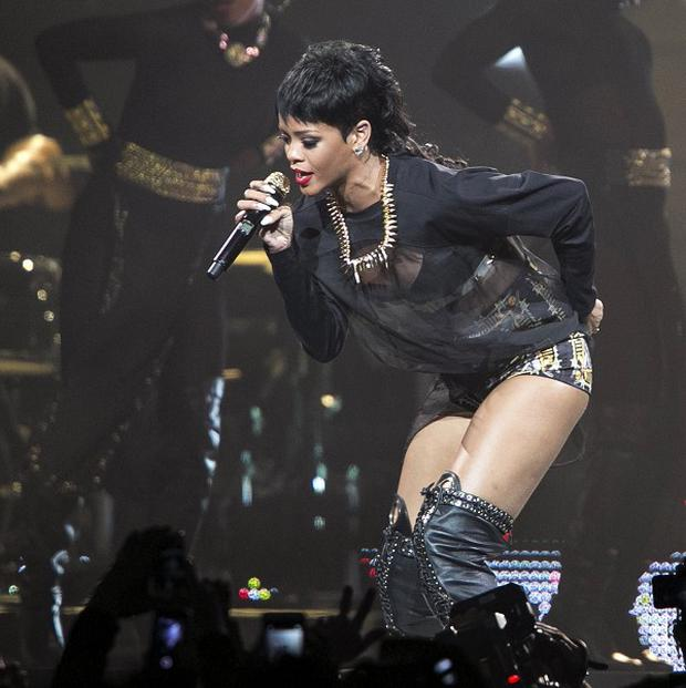 A Thai bar owner has been arrested over a lewd sex show mentioned in racy tweets by pop star Rihanna (AP)