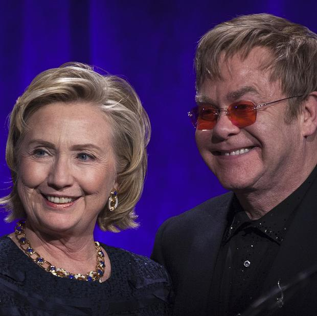 Hillary Clinton, left, and Sir Elton John, as she received an award from his AIDS Foundation in New York City.