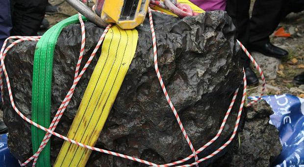 A chunk from the Chelyabinsk meteor, recovered from Chebarkul Lake near Chelyabinsk in Russia (AP)