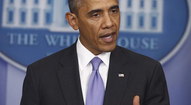 US President Barack Obama speaks after the Senate voted to avoid a financial default (AP)