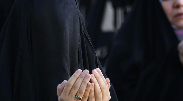 Iraqi Shiite Muslim women at prayer in Baghdad as Muslims all over the world celebrate Eid al-Adha (AP)