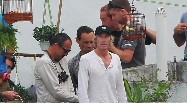 Director Michael Bay, centre, with members of his crew shooting Transformers Four in Hong Kong (AP)