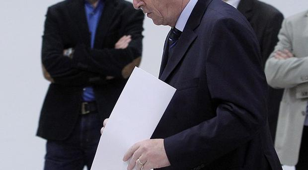 Luxembourg's prime minister, Jean-Claude Juncker, casts his vote at a polling station (AP)