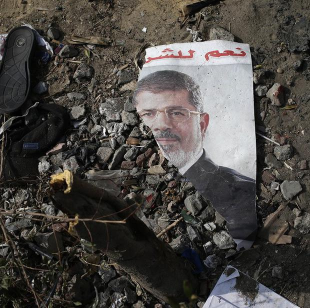 A trampled poster of Egypt's ousted President Mohammed Morsi is seen on the ground outside the Rabaah al-Adawiya mosque, (AP)