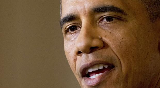 Barack Obama is unhappy with faults in the initial stages of his new health care scheme (AP)
