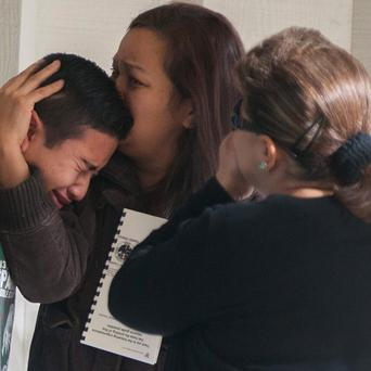 A pupil is comforted after the shooting at Sparks Middle School, Nevada.