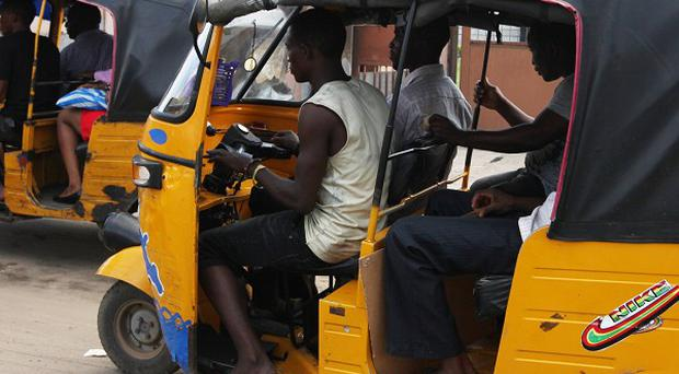 Islamic police in Nigeria have been arresting young taxi drivers seen sporting cut-off trousers and sleeveless T-shirts (AP/Sunday Alamba)