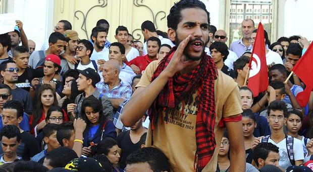 Protesters in Tunis call for the government to resign (AP)