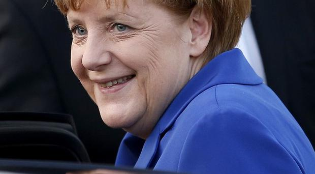 Chancellor Angela Merkel has called Barack Obama over claims her mobile phone was monitored ( (AP Photo/Michael Sohn)