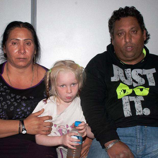 "The Roma couple with the little girl known as ""Maria""."