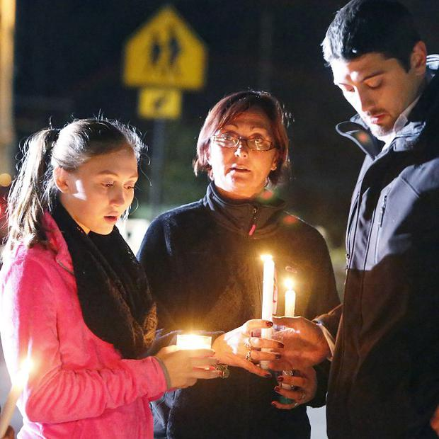Parents and Danvers High School students hold candlelight vigil to mourn the death of Colleen Ritzer (AP/ Bizuayehu Tesfaye)