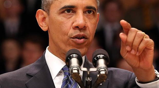 The Obama administration is asking Congress to hold fire on enacting new sanctions against Iran