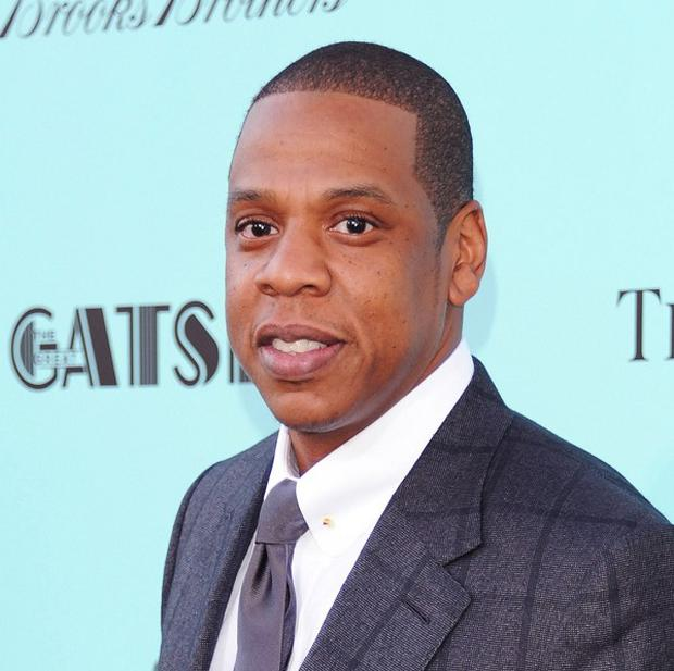 Rap mogul Jay-Z has defended himself against criticism over his collaboration with a top store at the centre of racial profiling claims.