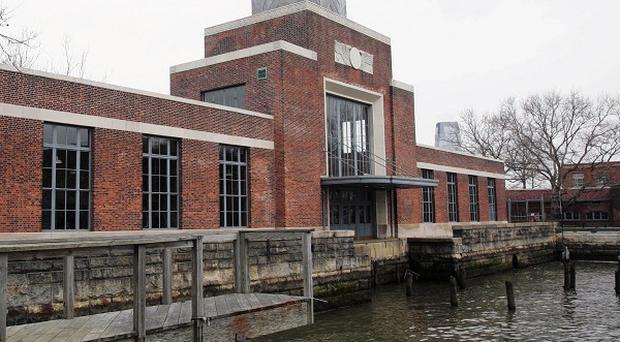 The Ellis Island Immigration Museum is reopening, a year after Superstorm Sandy raised water levels as high as 8ft at the former US immigration entry point.