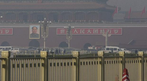Beijing's Forbidden City where a sport utility vehicle veered into a crowd then crashed and caught fire, killing three occupants and injuring tourists and security officers, police said.