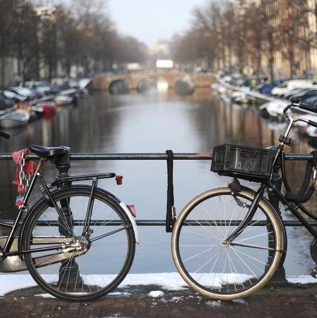 The Dutch have been warned to stop riding their bikes during storm winds sweeping the country