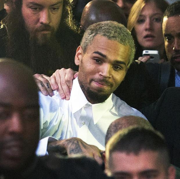 Singer Chris Brown leaves court (AP)
