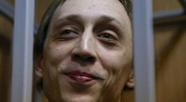 Bolshoi dancer Pavel Dmitrichenko, accused of being behind an acid attack against his artistic director, in court (AP)