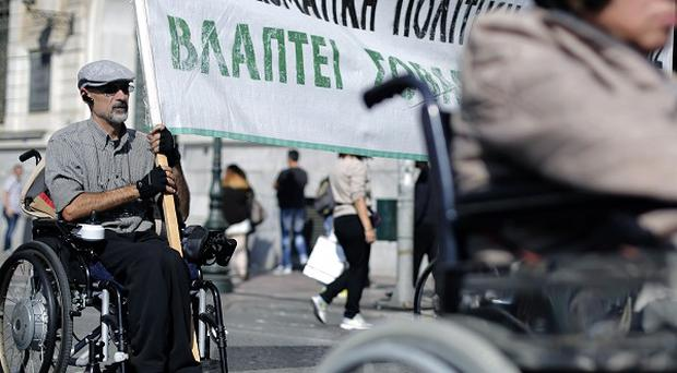 Retirees, the disabled and high school teachers were among thousands of protesters taking part in an anti-austerity protests in Athens (AP)