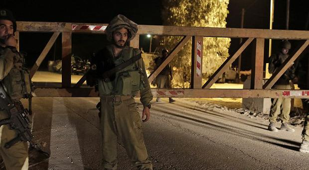Israeli soldiers keeping watch near the border between Israel and Gaza, as new clashes erupted (AP).