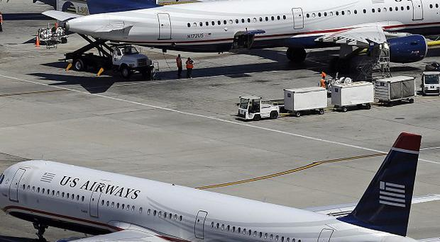 Jets at Los Angeles International Airport where a shooting has been reported (AP)