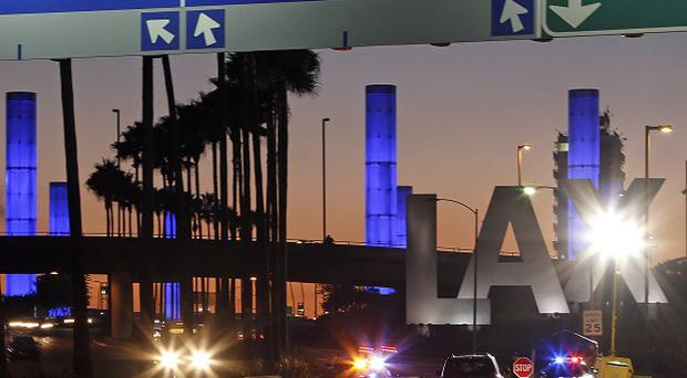 Pylons at the entrance to LAX, which normally flash in a multi-coloured sequence, shine a steady blue in honour of Gerardo Hernandez, the Transportation Security Administration officer killed on Friday.