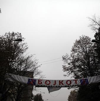A banner that reads Boycott for Albanian elections flies over a street in the northern, Serb-dominated part of Mitrovica, Kosovo. (AP)