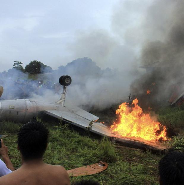 A plane burns after it crashed near an airport in Bolivia (AP/Bolivian Information Agency)