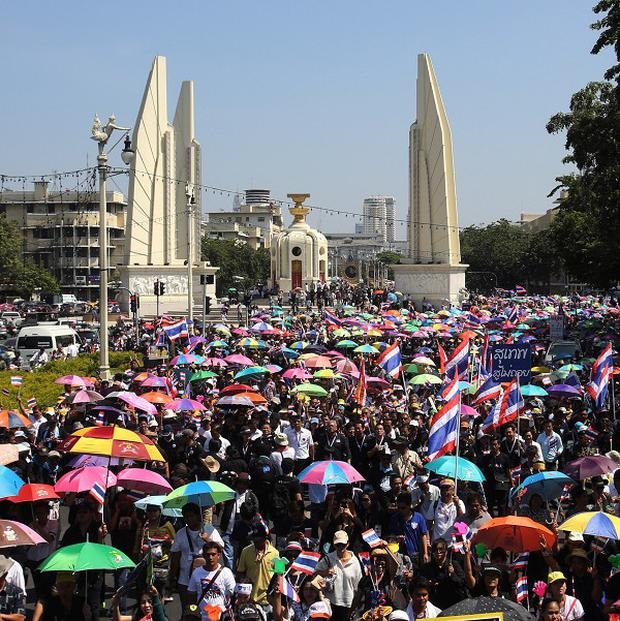 Demonstrators fill up the street during a rally in front of Democracy Monument in Bangkok (AP Photo/Sakchai Lalit)