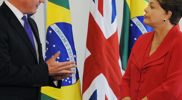 President Dilma Rousseff with Prime Minister David Cameron on a visit to Brazil last year.