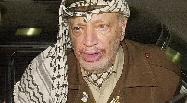 A scientist's report claims Yasser Arafat may have died from poisoning (AP)