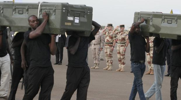 The coffins of Ghislaine Dupont and Claude Verlon are carried during a ceremony in their honour in Mali (AP)
