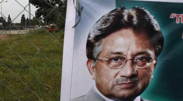 A poster of former Pakistani president Pervez Musharraf hangs near a checkpoint outside his house in Islamabad (AP)