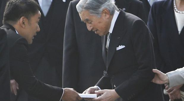 Taro Yamamoto, second left, hands over a letter to Japan's Emperor Akihito, second right, as Empress Michiko, right, looks on during the autumn garden party at the Imperial Palace in Tokyo (AP).