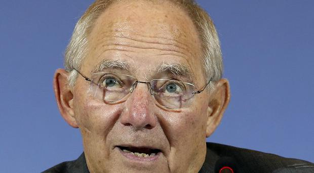 German Finance Minister Wolfgang Schaeuble has seen the country's trade surplus reach a record high (AP)