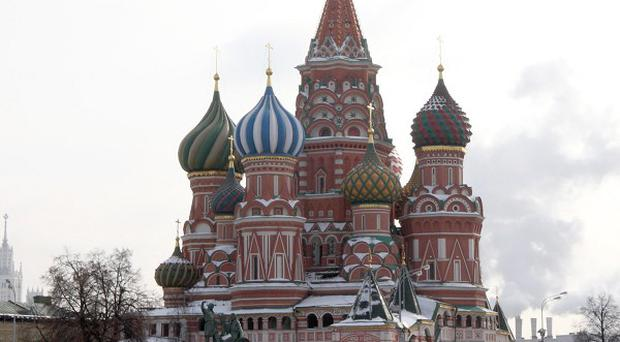 A demonstrator has carried out a painful protest in Moscow's Red Square