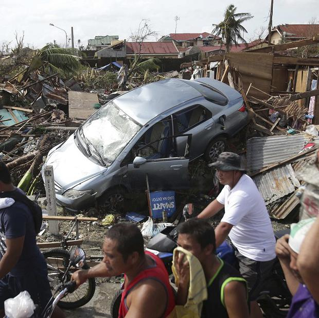Rescue workers face a daunting task in the typhoon-battered islands of the Philippines