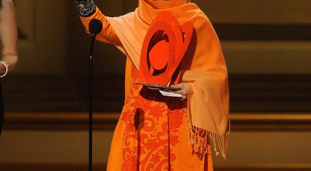 Malala Yousafzai accepts an award on stage at the 2013 Glamour Women of the Year Awards in New York (AP)